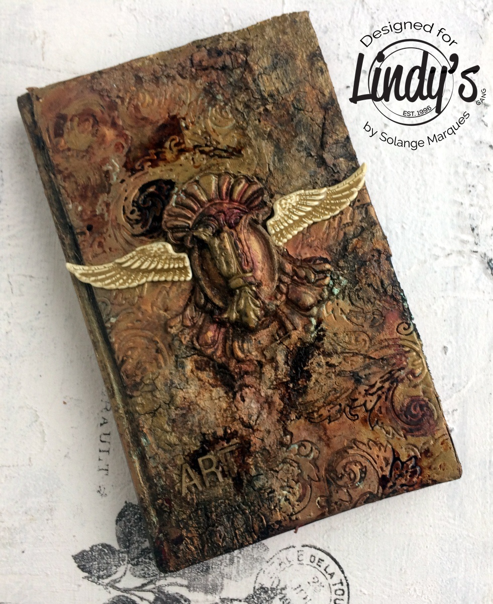 Altered Antique Book using Lindy's Starbursts and Magicals